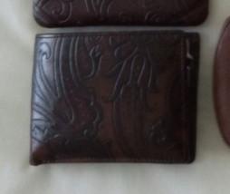二つ折り財布〈ETRO〉